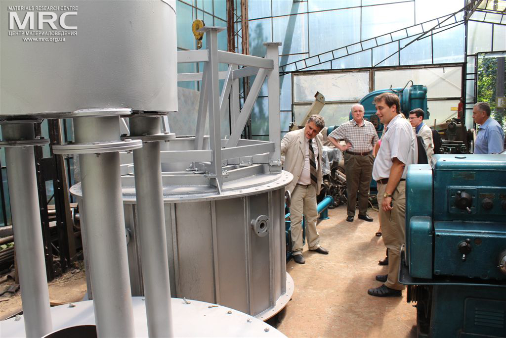 Project participants at MRC work premises observed equipment manufactured by MRC. From left to right: O.Gogotsi, Director of Materials Research Centre, STCU's Deputy Executive Director (USA) Vic Korsun, Igor Barsukov (American Energy Technologies Company, USA), Andrew Castiglioni (Argonne National Laboratory, USA), project manager M.Gubinskiy (DMetAU)