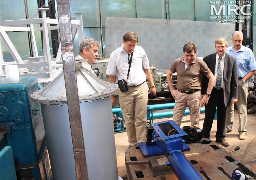 At the photo from left to right: O.Gogotsi, MRC Director, Igor Barsukov (American Energy Technologies Company, USA), project manager S.Saenko (KIPT), project technical monitor Dave Carter (Argonne National Laboratory, USA), project manager M.Gubinskiy (NMetAU), at MRC work premises, August 2013