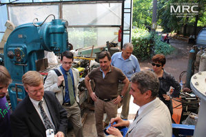 Inspecting the control units for auxilliary equipment, manufactured by MRC. from left to right: T. Moshnyaga (MRC), project technical monitor Dave Carter and Andrew Castiglioni (Argonne National Laboratory, USA), O.Gogotsi, MRC Director, project manager S.Saenko (KIPT),  project manager M.Gubinskyi (NMetAU),  I.Tomashevskaya (STCU), Materials Research Centre, August 2013