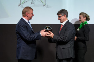 Chairman of the Executive Board of RUSNANO Anatoly Chubais handed prof. Yury Gogotsi with RUSNANOPRIZE 2015 Award