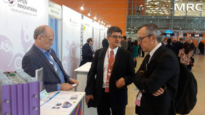 Prof. Yury Gogotsi, Drexel University (USA), and prof. Patrice Simon, Paul Sabatier University (Toulouse, France) near the exibition stand of TEEMP LLC Company