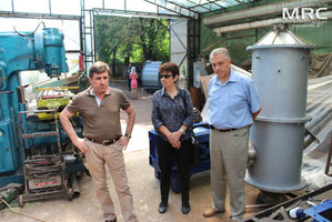 At the photo from left to right: S.Saenko (KIPT),  I.Tomashevskaya (STCU), M.Gubinskiy (DMetAU) observed equipment, manufactured due to the research and development project, MRC work premises, August 2013