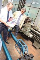 Project collaborator Joseph Doninger (Dontech Global Inc., USA),  and O. Gogotsi (MRC Director) inspected screw feeders, manufactured by MRC, Materials Research Centre, August 2013